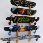 Skateboard rack featuring 5 skateboards on a wooden fixture