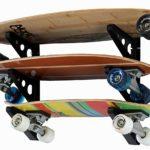 3 skateboards on a metal rack