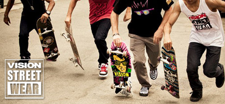 Waist down action photo of 5 guys with vision skateboards about to run start